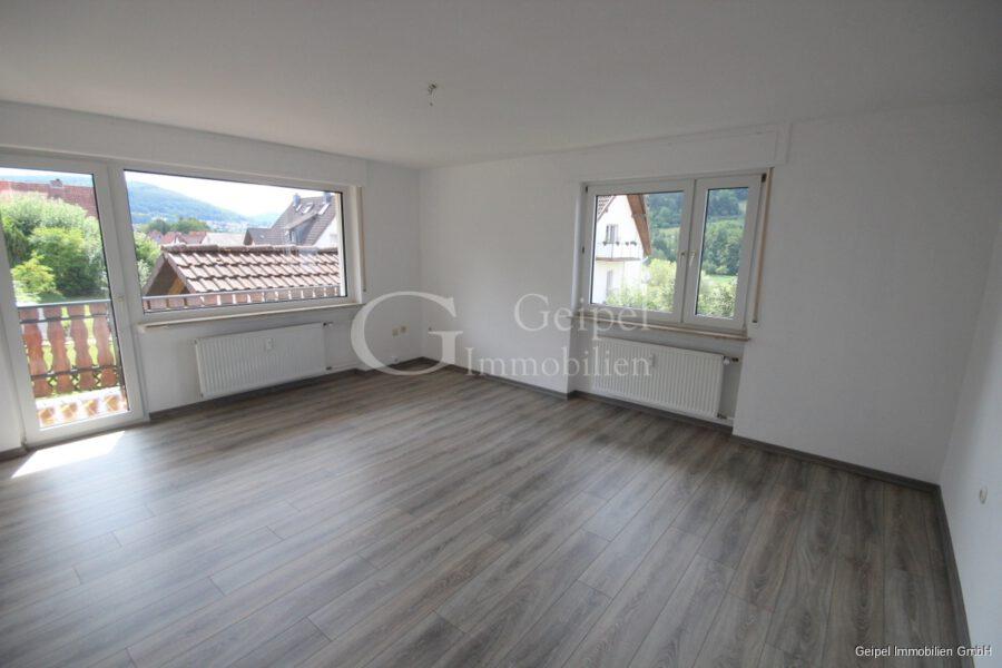 VERMIETET Hier sind Sie willkommen - Wohnzimmer mit Balkon
