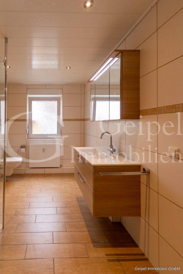 hochwertige Erdgeschosswohnung mit Terrasse - Bad