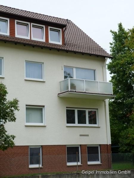 VERMIETET Mittendrin und trotzdem ruhig! mit Balkon und Einbauküche - Seitenansicht